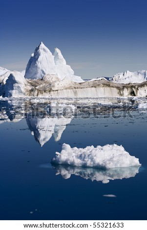 Iceberg and its reflexion - stock photo