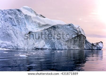 Iceberg at arctic ocean in Greenland - stock photo