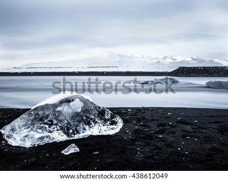 Iceberg at the black Beach in Iceland - stock photo