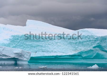 Iceberg close up, aquamarine color - stock photo