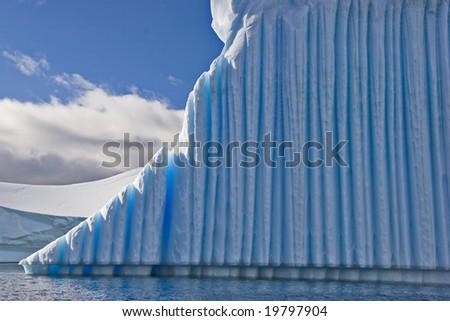 Iceberg closeup with deep blue ice - stock photo
