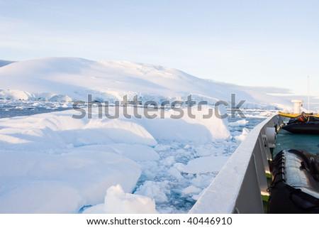 iceberg confronting a ship - stock photo
