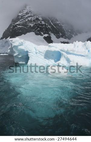 Iceberg in Antarctic waters - stock photo