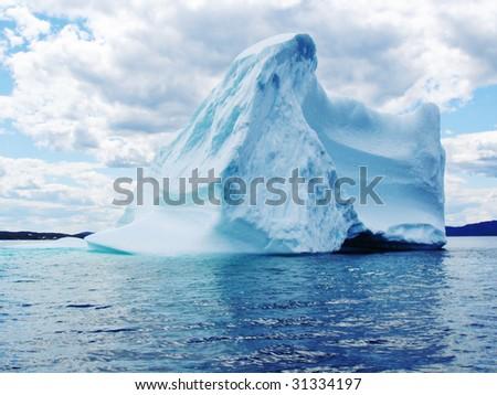 Iceberg in Atlantic Ocean off Newfoundland - stock photo