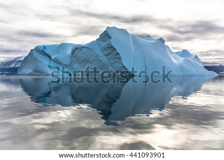 Iceberg in Greenland. You can only see the top of the iceberg, whilst the remaining 7/8 is left to your imagination. - stock photo