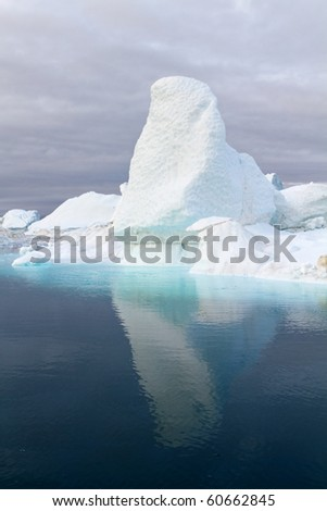 Iceberg in the famous icefjord beside the city of Ilulissat in Greenland. The icefjord is on UNESCO's World Heritage List. - stock photo