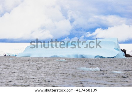 Iceberg in the sea - stock photo