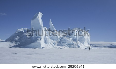 Iceberg in the sea ice on Antarctica - stock photo