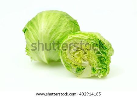 Iceberg lettuce and one cut half, on white background. - stock photo