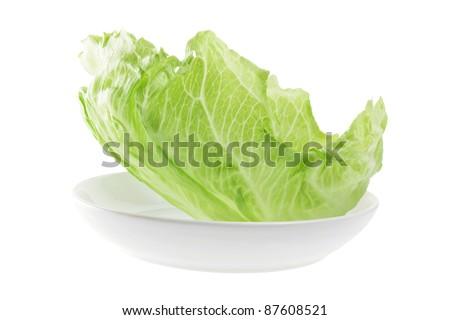 Iceberg Lettuce on Plate with White Background - stock photo