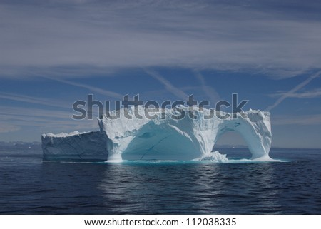 Iceberg off the coast of Greenland - stock photo