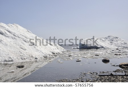 iceberg on lakeshore - stock photo