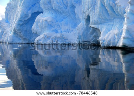 iceberg reflected in the water - stock photo