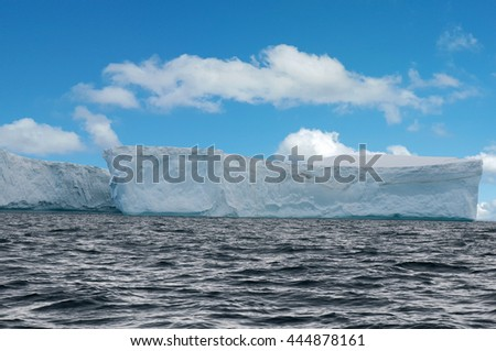 Iceberg wall in the sea at the Antarctica - stock photo