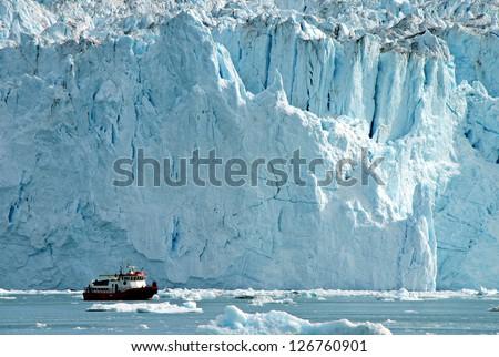 iceberg with ship - stock photo