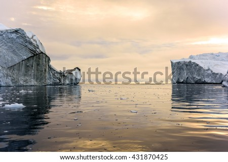 Iceberg with sunset on arctic ocean at Greenland - stock photo