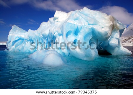 iceberg worn away by the sea - stock photo