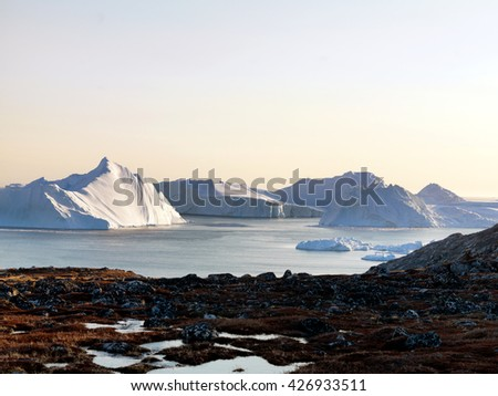 Icebergs and glaciers at the north pole of the world, in Ilulissat, Greenland. - stock photo
