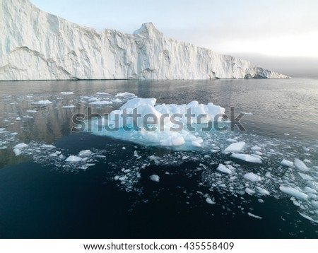 Icebergs are melting on arctic ocean in Greenland - stock photo