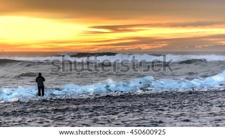 Icebergs at sunset, Jokulsarlon ice lagoon in Iceland - stock photo