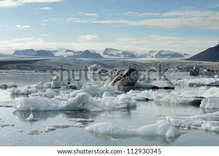 Icebergs calving into Jokulsarlon lagoon, Iceland - stock photo