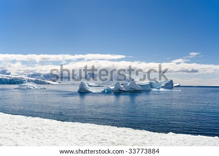 icebergs drifting in a bay - stock photo