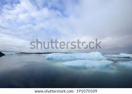 icebergs float in a glacial lake in Southern Iceland