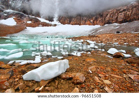 Icebergs float in glaical meltwater from the Angel Glacier in Jasper National Park of Canada - stock photo