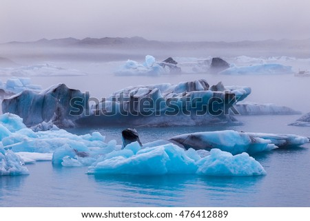 Icebergs floating in Fjallsarlon glacier lake at sunset. South Iceland.Close to Jokulsarlon lagoon./ Icebergs floating in Fjallsarlon glacier lake at sunset.