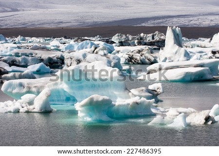 Icebergs floating in the glacial lagoon in Iceland - stock photo