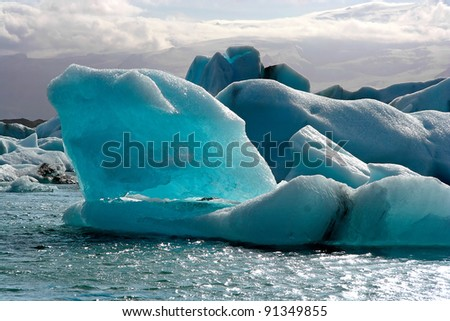 Icebergs floating on Jokulsarlon lake - stock photo