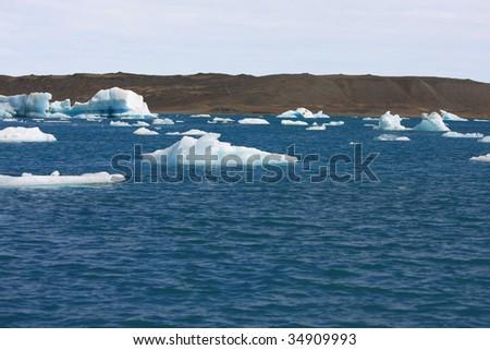 Icebergs floating toward the ocean. - stock photo