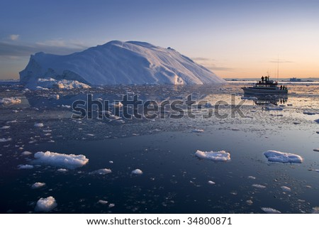 Icebergs in a wide perspective in the fjord of Ilulissat, Greenland. Boat. - stock photo