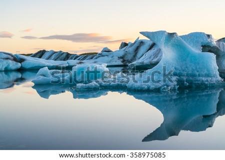 Icebergs in Jokulsarlon glacial lake at sunset, Iceland - stock photo