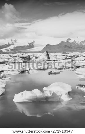 Icebergs in Jokulsarlon lagoon, Iceland. Famous lake. Travel destination for tourists next to Vatnajokull glacier. Black and white toned image. - stock photo