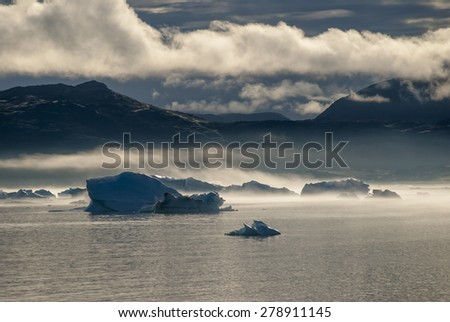 Icebergs in Narsuaq at sunset - stock photo