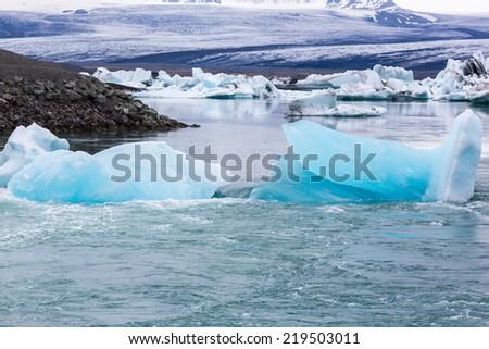 Icebergs in the glacier lagoon in Iceland Ekulsarlon - stock photo