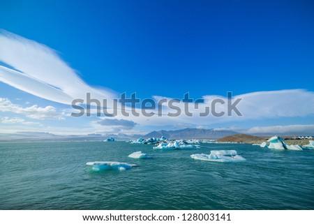 Icebergs in the glacier lake Jokulsarlon, glacier Vatnajokull, Iceland. - stock photo