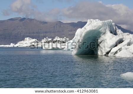 Icebergs in the glacier lake Jokulsarlon, Iceland  - stock photo