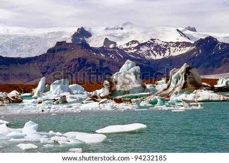 Icebergs in the glacier lake Jokulsarlon, Iceland - stock photo