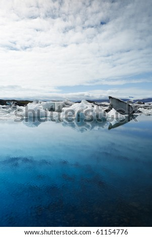 Icebergs melting at deep blue Jokulsarlon Lagoon, Iceland. - stock photo