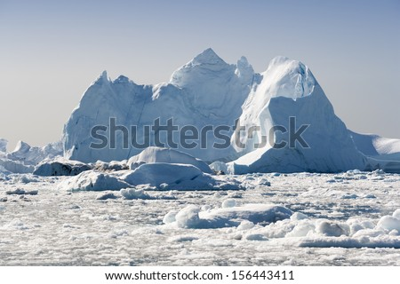 Icebergs of fantastic forms. Summer in Greenland. Deep-water fjords of the Western coast. - stock photo
