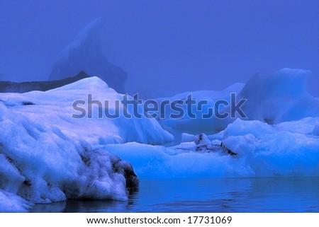 Icebergs of Jokulsarlon lagoon by misty weather, Iceland - stock photo