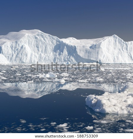Icebergs of polar regions. Research of effect of global warming on a scientific vessel. - stock photo