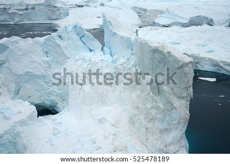 Icebergs on arctic ocean in Greenland