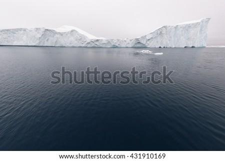 Icebergs on arctic ocean in Ilulissat Icefjord, Greenland - stock photo