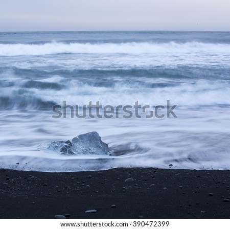 Icebergs washed up on blank sand beach near Jokulsarlon glacial lagoon, Iceland   - stock photo