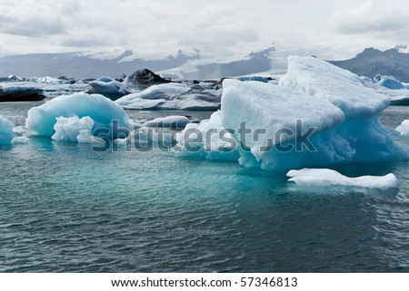 Icebergs which are born from the Vatnajökull glacier go their way to the sea passing Icelands famous Jökulsarlon Bay - stock photo