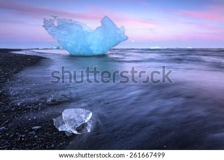 Icebregs on black volcanic beach Jokulsarlon in south Iceland/ Icebergs on beach - stock photo