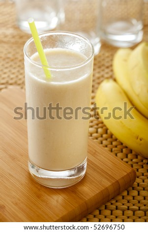icecold served milkshake with banana - stock photo
